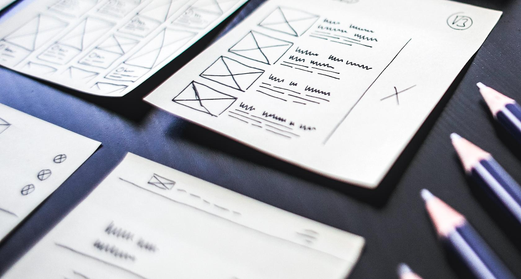 Wireframes drawn on the paper during web design process