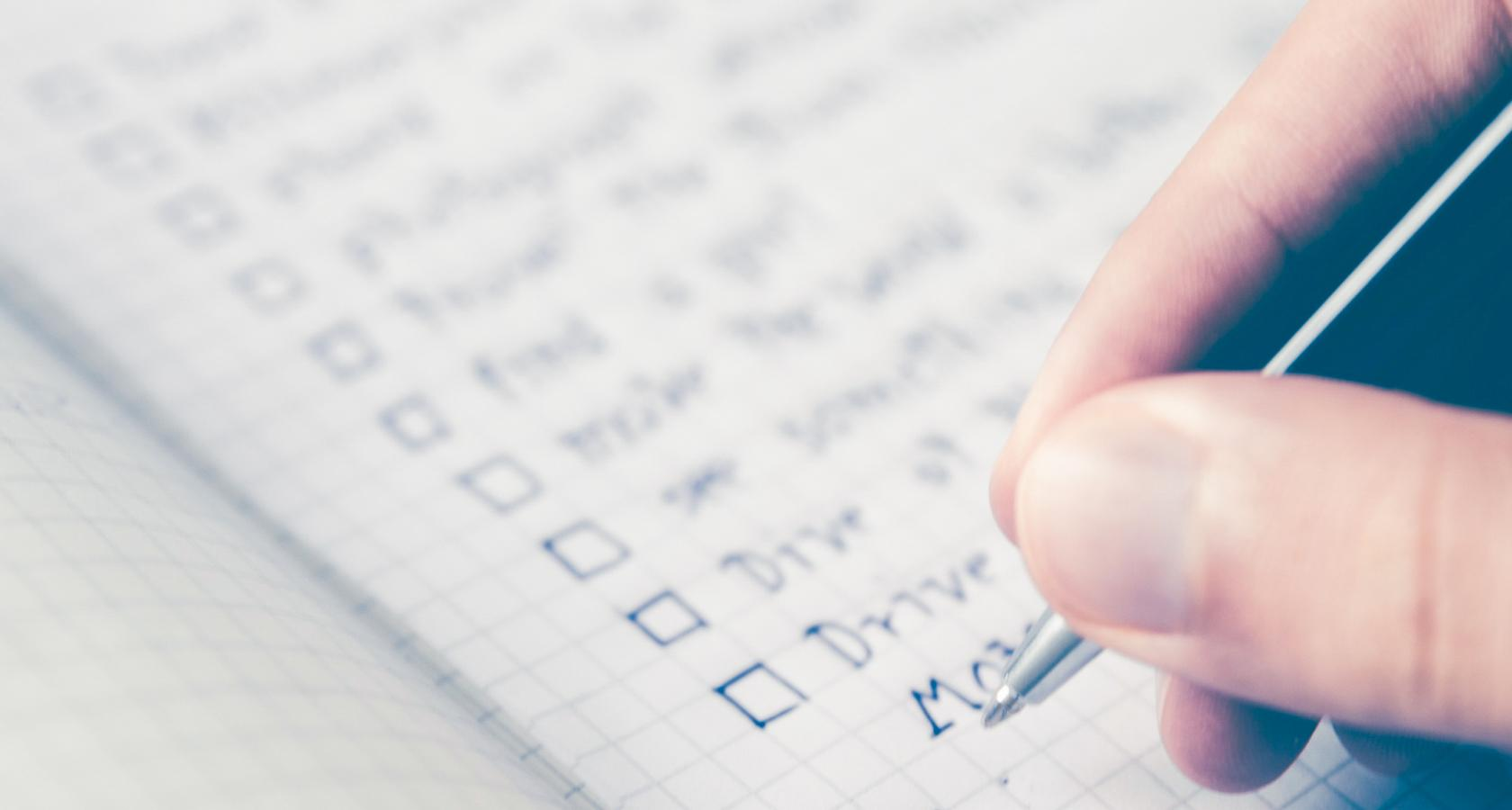Web designer working on a final project checklist