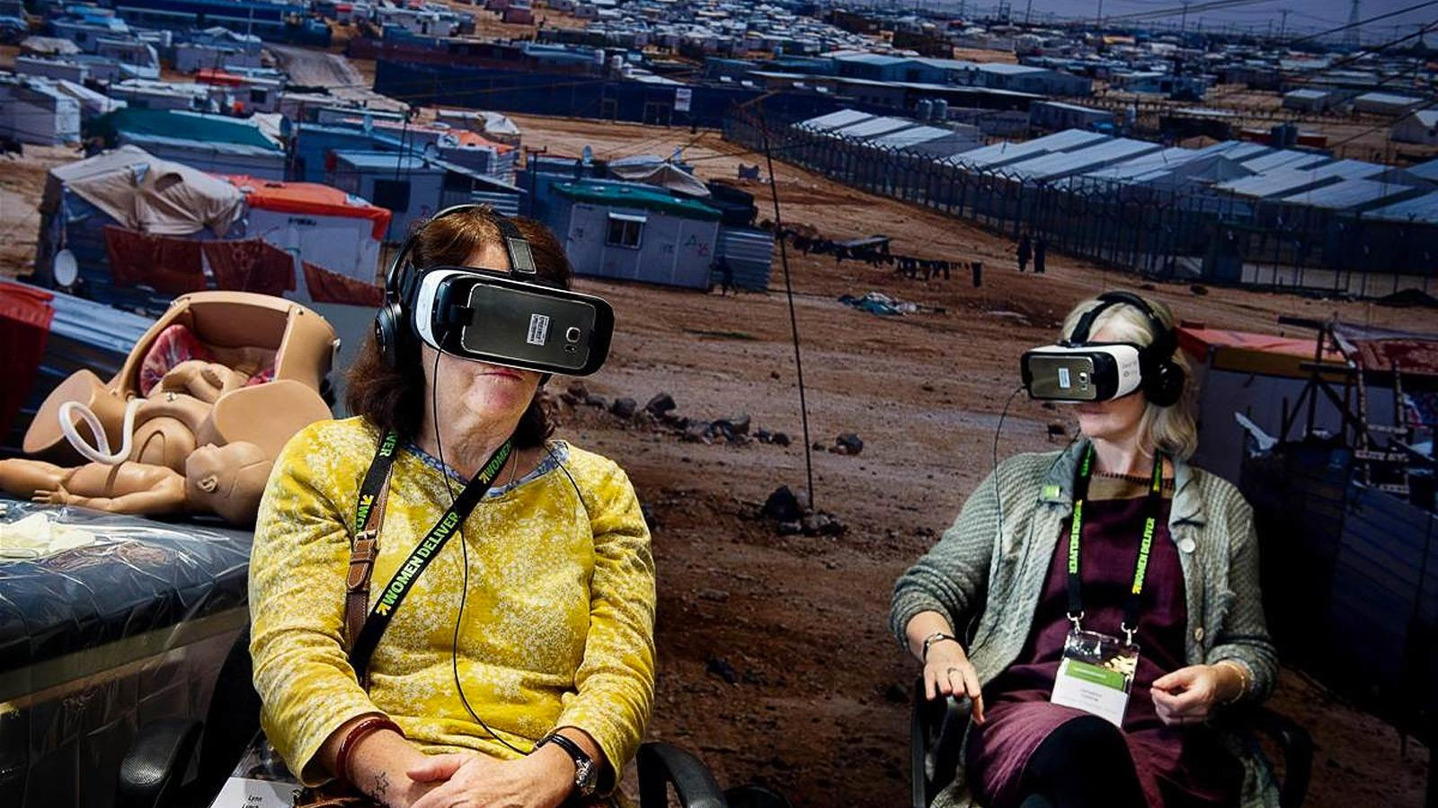 VR users projected in a 360 view of a refugees camp
