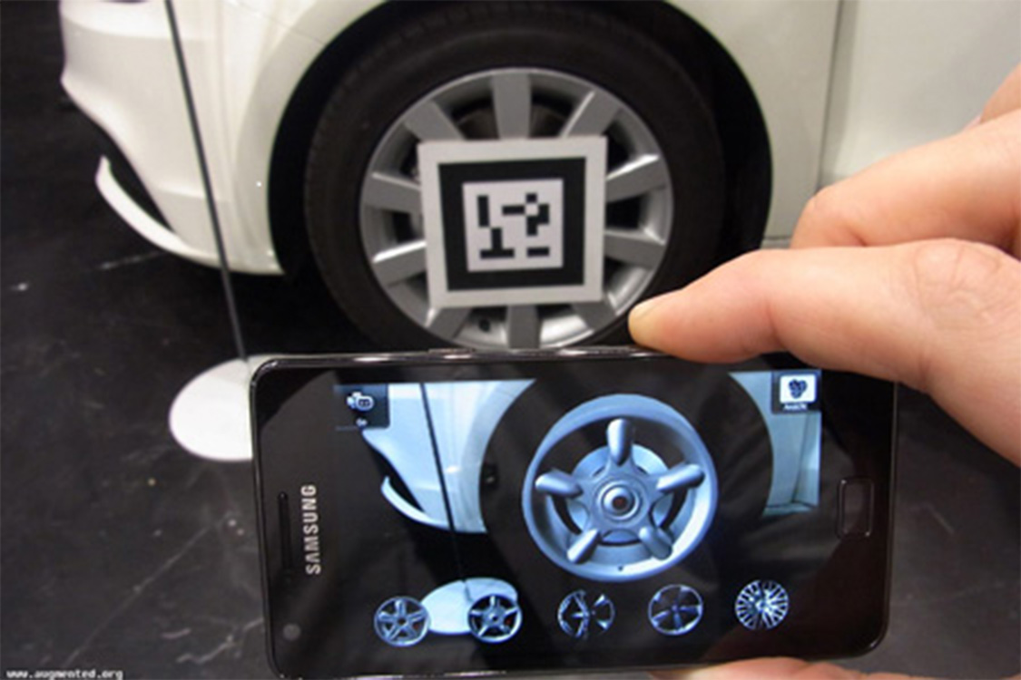 A marker-based AR app recognizing a marker on a car wheel's hubcap