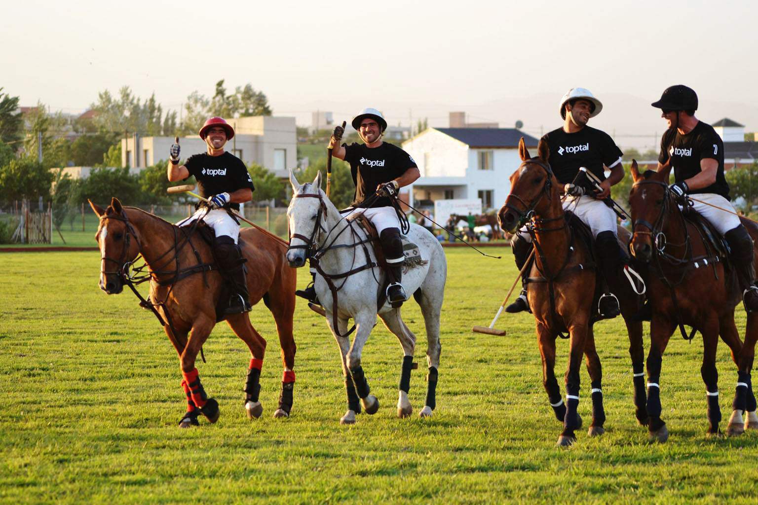 How to travel while working the right way? Play polo in Argentina with a company t-shirt on.