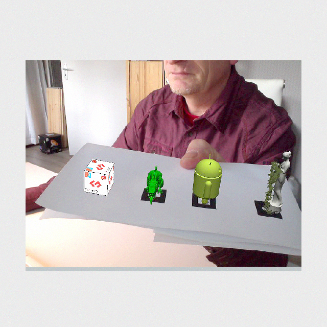 Results of Picshare in-browser augmented reality application with multiple markers.